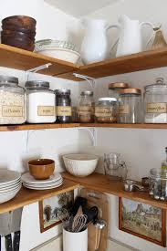how to organize open kitchen cabinets 10 tips to organize kitchen open shelves the by