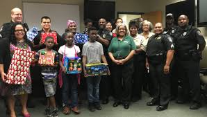 famu department gives gifts to local family