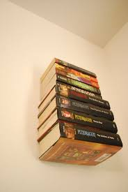 Build Wall Shelves Without Brackets by How To Make An Invisible Bookshelf Without Ruining A Book 9