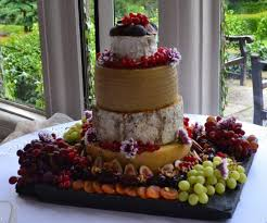 cheese barrel wedding cake in 4 tiers with fresh and dried fruit
