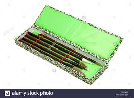 five calligraphy brushes in ornamental box stock photo