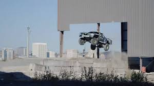 watch monster truck videos video watch a trophy truck chase bigfoot and jump everything