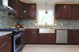 what backsplash looks with cherry cabinets cherry cabinets with mosaic glass and backsplash with