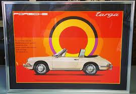 vintage orange porsche vintage poster framing denver fastframe of lodo expert picture
