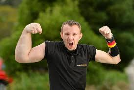 arm wrestler with one arm bigger than the other proves he has the