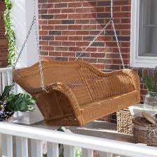 honey resin wicker porch swing with comfort spring and hanging