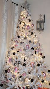white tree with pink black and silver ornaments
