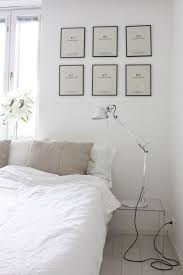 homevialaura white bedroom with artemide tolomeo lamps linen