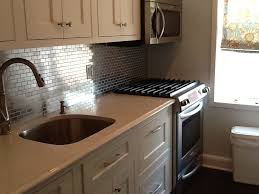 kitchens with stainless steel backsplash stainless steel backsplash with shelf dark metal stove big