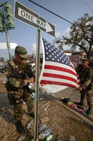 Famous Picture Of Soldiers Putting Up Flag 19 Stunning Pictures Of Hurricane Katrina U0027s Aftermath