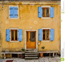 front of an old house with blue shutters stock image image 19759077