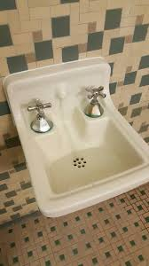 strange sink like thing in the the bathroom of a college dorm the