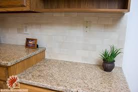 crema marfil tile with giallo ornamental granite counter top