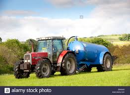 slurry spreading with a vacum tanker on back of a massey ferguson