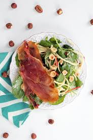 apple noodle and prosciutto baby kale salad with roasted hazelnuts