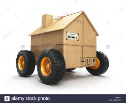 cardboard house box with wheels isolated on white background