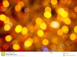 dark brown yellow and red blurred christmas lights stock photo