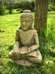 large garden buddha statues beautify the landscaping with a garden