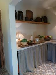 love the curtains instead of kitchen cabinet doors also the tiny
