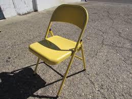 lot detail five yellow metal folding chairs