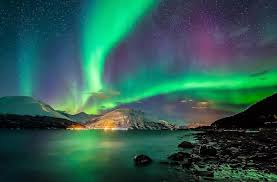 what creates the northern lights dazzling view of the northern lights dancing over a partially frozen