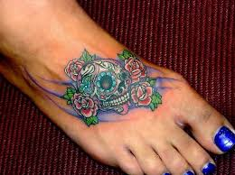 colorful sugar skull with lovely small flower