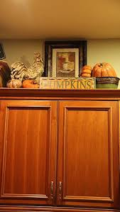 how to decorate above kitchen cabinets for fall pin by mews on kitchen decorating above kitchen