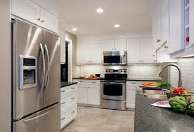 grey granite countertops added by white wooden kitchen cabinet and
