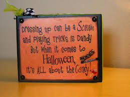 cute sign dressing up can be a scream and playing tricks is dandy