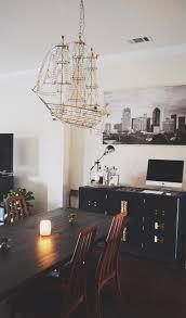 ralph lauren lamp moky and marisa ship chandelier over dining room table