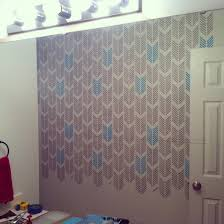 bathroom stencil ideas a drifting arrows stenciled bathroom makeover stencil stories