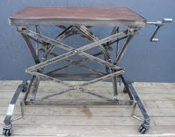 polished steel and mahogany scissor lift trolley table hire only