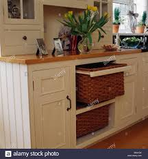 storage unit with wicker baskets wicker storage baskets on shelving in cream painted fitted unit in
