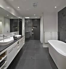 bathroom floor to roof charcoal tiles with a black counter and black and white bathroom benches are caesarstone