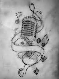 small music tattoo on chest for women photos pictures and