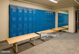 locker benches gym locker room with wooden benches and blue lockers stock photo