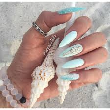 tiffany blue stiletto nails with glitter and silver accents nail