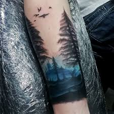 blue ink sky watercolor mens forearm tree tattoos tattoos