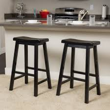pomeroy 24 inch saddle wood counter stool set of 2 by