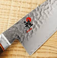 what kitchen knives do i need what makes a high performance kitchen knife and do you need one kkg