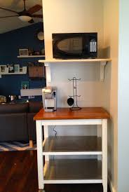 diy wood wall mounted microwave shelf above table with rack