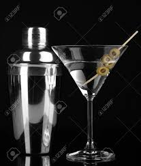 martini black martini glass with olives and shaker isolated on black stock photo