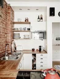 Small Stylish Apartment That Looks Warm Cozy And Inviting Bricks - Warm interior design ideas