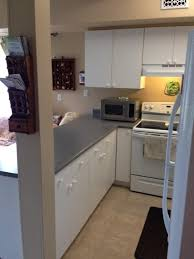 support beam in front of fridge in basement suite kitchen awkward