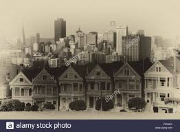 victorian style houses on the steiner street with skylines in the