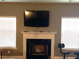 wall mounted ideas pictures lcd tv near fireplace over lcd tv over