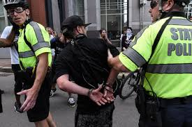 boston police arrest 27 people during protests around u0027free speech