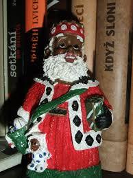 black santa figurines gather in republic anewscafe