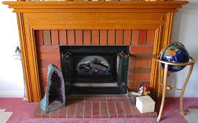 lighting wood fireplace surround and brick with dimplex electric