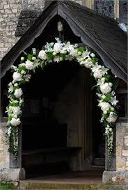 wedding arches ireland an arch decorating the entrance to a church flowers and stuff